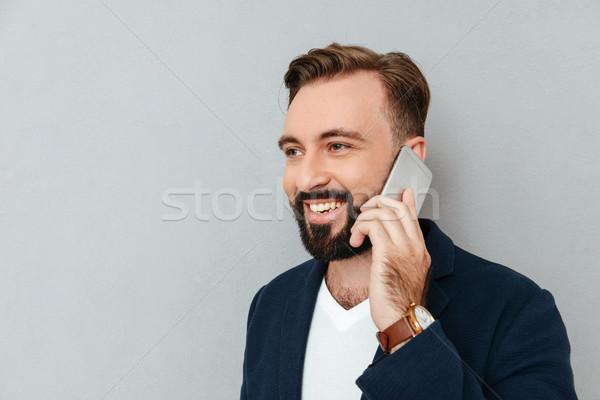 肖像 ハンサムな男 話し スマートフォン 孤立した ハンサム ストックフォト © deandrobot
