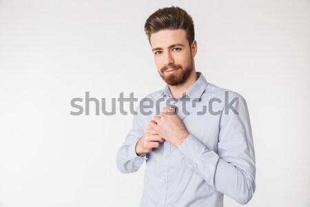 Ernstig bebaarde man business kleding wijzend Stockfoto © deandrobot