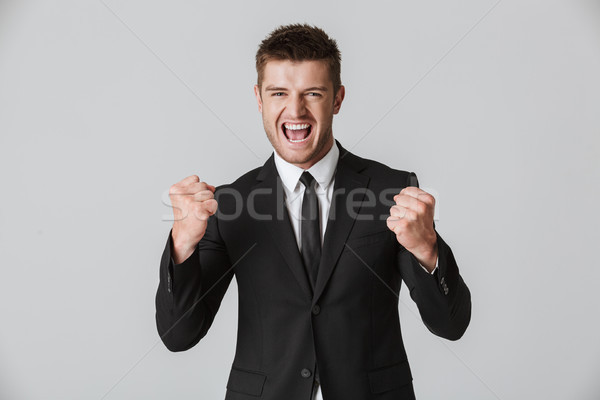 Portrait of an angry young businessman in suit Stock photo © deandrobot