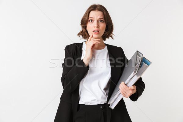 портрет недоуменный молодые деловая женщина черный куртка Сток-фото © deandrobot