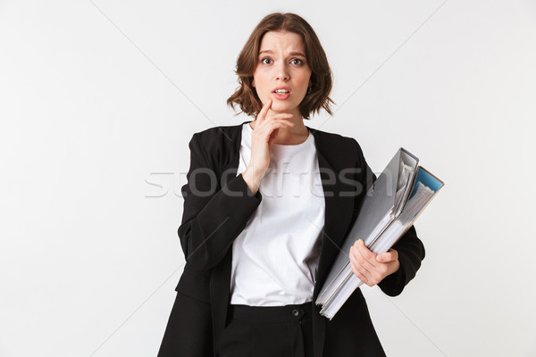 Portret onzeker jonge zakenvrouw zwarte jas Stockfoto © deandrobot