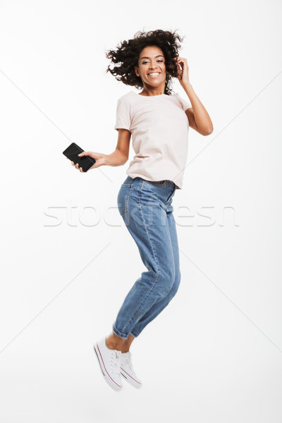 Full length image of happy african american woman with brown cur Stock photo © deandrobot