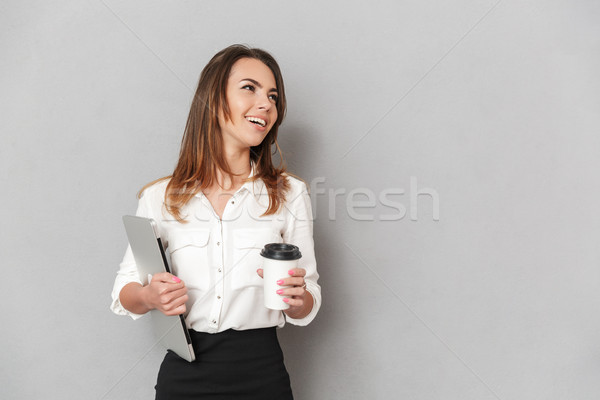 Portrait of a happy young business woman looking away Stock photo © deandrobot