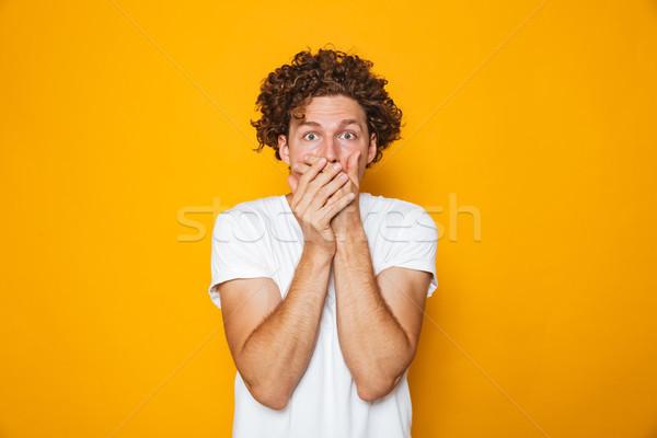 Portré megrémült fürtös férfi befogja száját izolált Stock fotó © deandrobot
