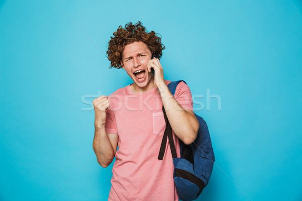 Foto aufgeregt College guy lockiges Haar tragen Stock foto © deandrobot
