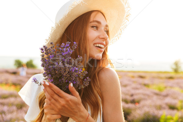 Pretty young girl in straw hat Stock photo © deandrobot