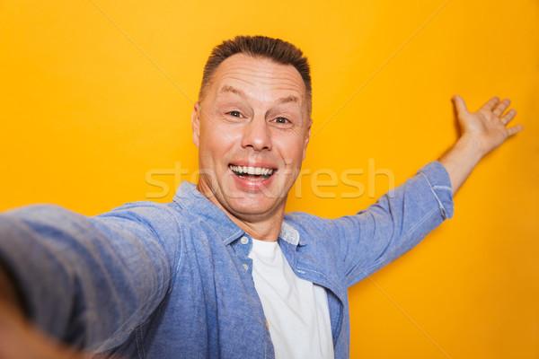 Portré mosolyog középkorú férfi elvesz kéz izolált Stock fotó © deandrobot