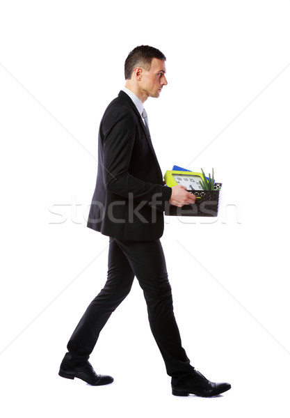 You are fired! Businessman hold box with personal belongings isolated on white background Stock photo © deandrobot