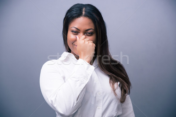 African businesswoman covering her nose Stock photo © deandrobot