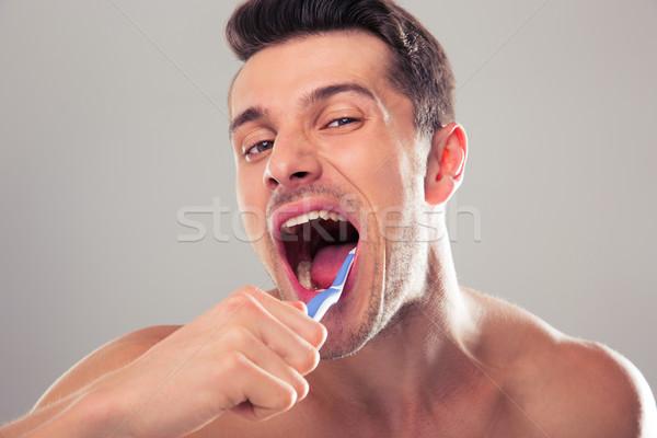 Jonge man grijs gelukkig medische borstel Stockfoto © deandrobot