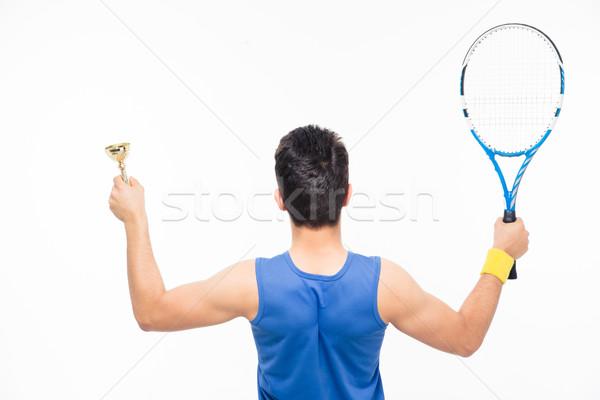 Férfi tart teniszütő csésze hátulnézet portré Stock fotó © deandrobot