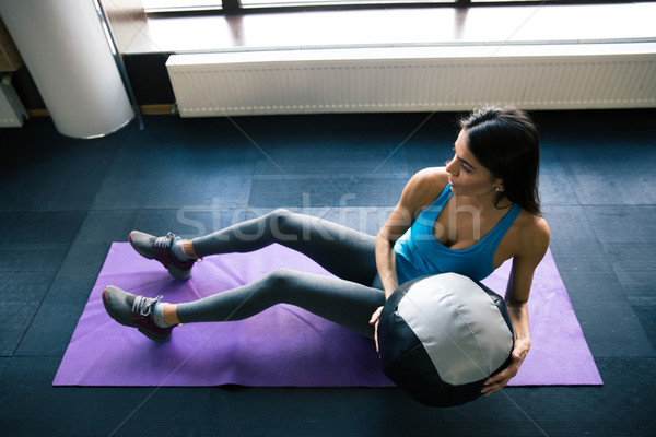 Young woman working out with fit ball  Stock photo © deandrobot