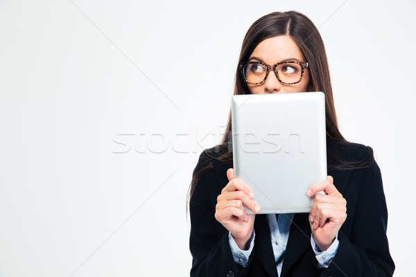 Businesswoman covering her mouth with tablet computer  Stock photo © deandrobot