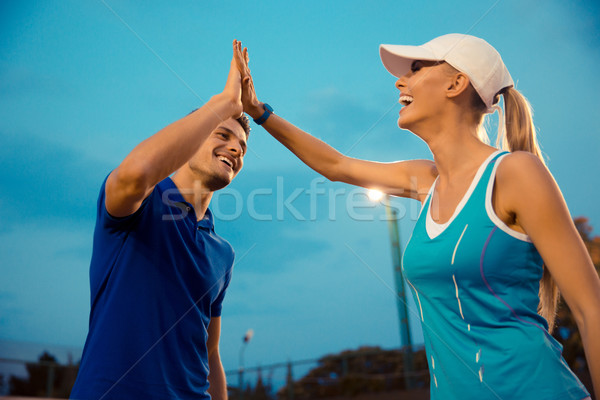 Portrait of a man and woman gives five Stock photo © deandrobot