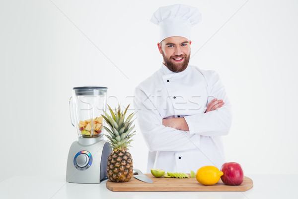 Smiling chef cook standing with arms folded  Stock photo © deandrobot