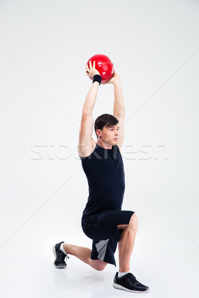 Athletic man workout with fitness ball  Stock photo © deandrobot