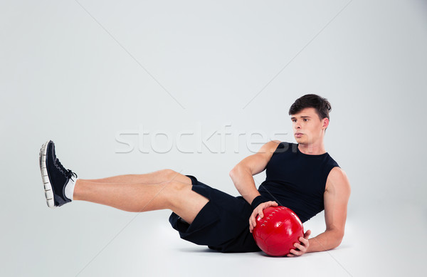 Portrait of athletic man workout with fitness ball Stock photo © deandrobot