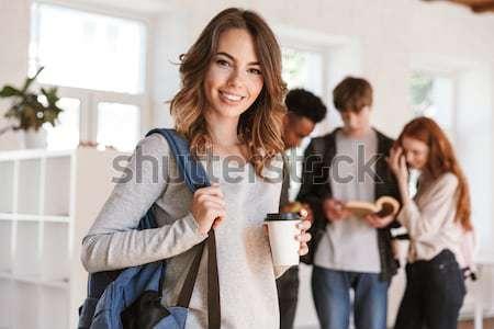 Сток-фото: счастливым · женщины · студент · смартфон · портрет · афро