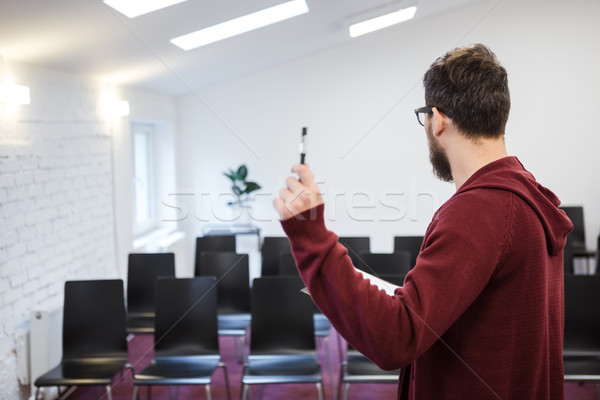 Speaker standing in white conference room. Backside Stock photo © deandrobot