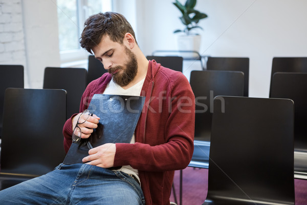 ハンサム 男 座って クリップボード 男 ストックフォト © deandrobot