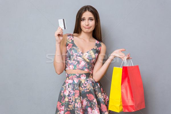Smutne rozczarowany dość dziewczyna karty kredytowej kolorowy Zdjęcia stock © deandrobot