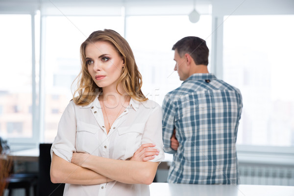 Unhappy woman in quarrel with her husband at home Stock photo © deandrobot