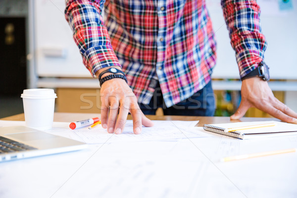 Hands of young man standing and working in conference room Stock photo © deandrobot