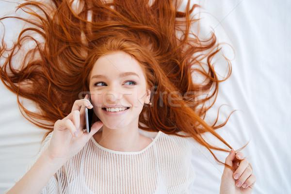 женщину говорить сотового телефона кровать Сток-фото © deandrobot