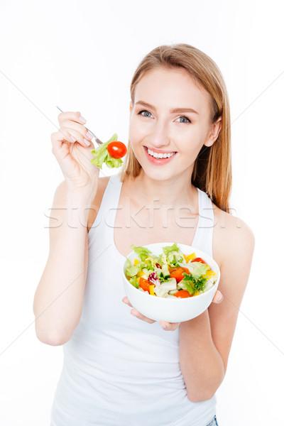 Mosolygó nő eszik saláta izolált fehér háttér Stock fotó © deandrobot