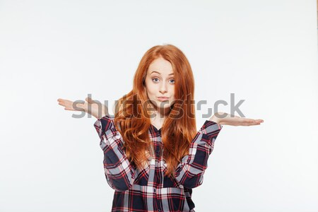 Woman showing copyspace on the palms Stock photo © deandrobot