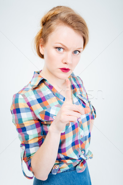 Angry woman wagging finger Stock photo © deandrobot