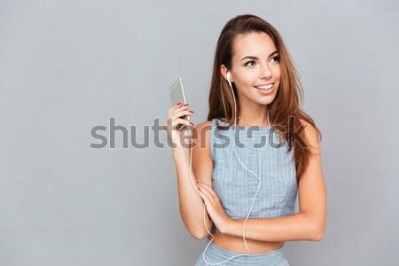 Glimlachend cute jonge vrouw lippenstift spiegel portret Stockfoto © deandrobot
