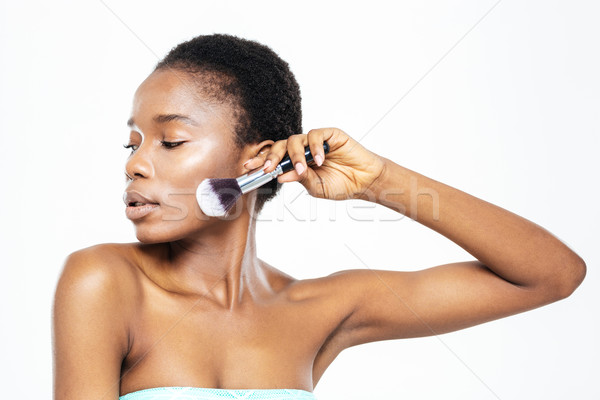 Afro american woman posing with makeup brush  Stock photo © deandrobot
