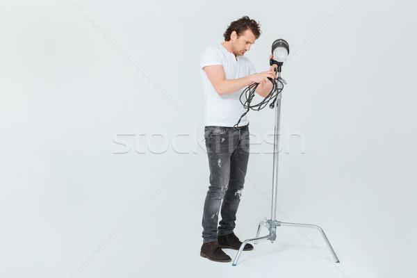 мужчины фотограф осветительное оборудование изолированный белый человека Сток-фото © deandrobot