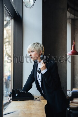 Blonde stylish girl using old fashioned telephone Stock photo © deandrobot