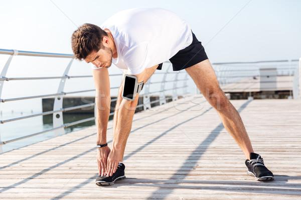Jonge benen training pier Stockfoto © deandrobot