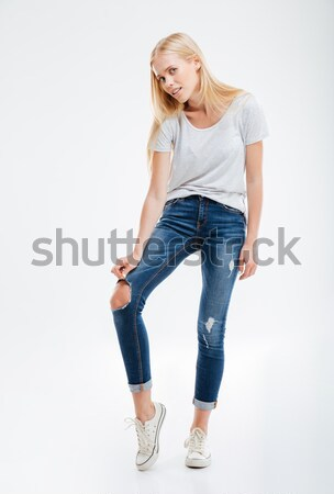 Depressed young woman showing ripped pants Stock photo © deandrobot