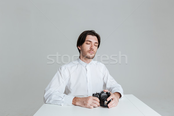 Man sitting with eyes closed Stock photo © deandrobot