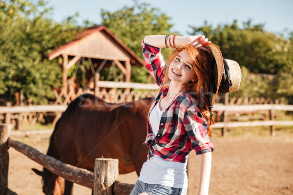 Happy woman cowgirl with horse on ranch Stock photo © deandrobot