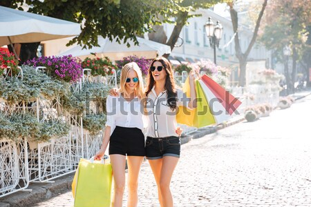 Beautiful women with shopping bags in the city Stock photo © deandrobot