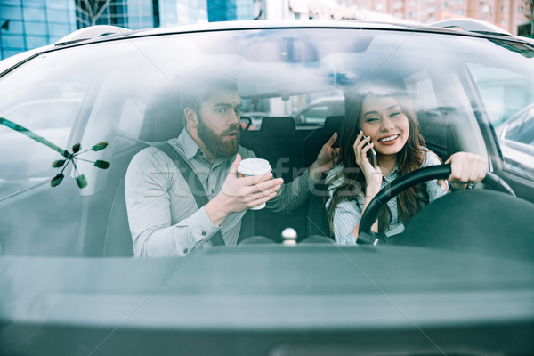 Front image of couple in car Stock photo © deandrobot