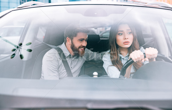 Young woman and man in car Stock photo © deandrobot