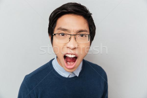 Screaming asian student Stock photo © deandrobot