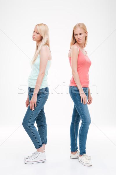Smutne damska dżinsy stwarzające zdjęcie dwa Zdjęcia stock © deandrobot