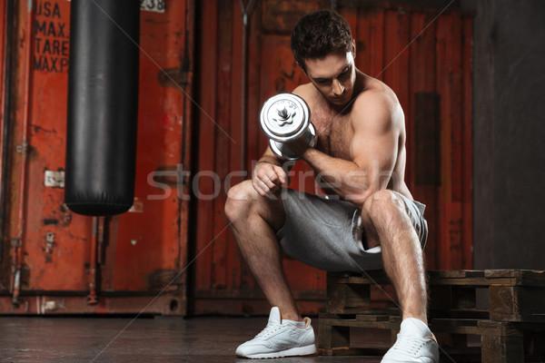 Strong man make sport exercises with ecquipment Stock photo © deandrobot