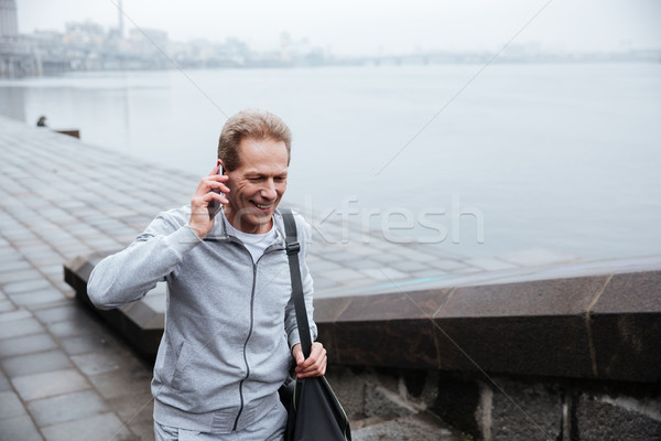 Runner talking at phone and walking on stairs Stock photo © deandrobot