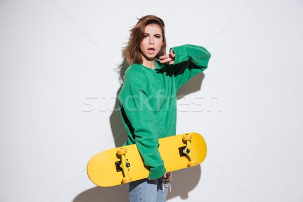 красивой фигурист женщину скейтборде изображение зеленый Сток-фото © deandrobot