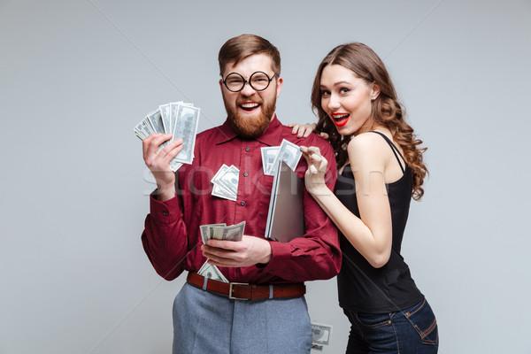 Sluw vrouw stick mannelijke nerd geld Stockfoto © deandrobot