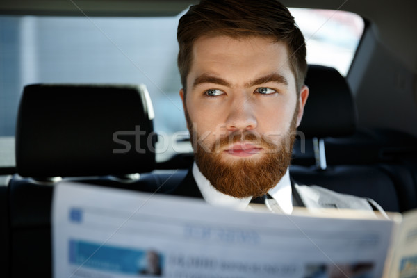 Thoughtful business man with newspaper Stock photo © deandrobot