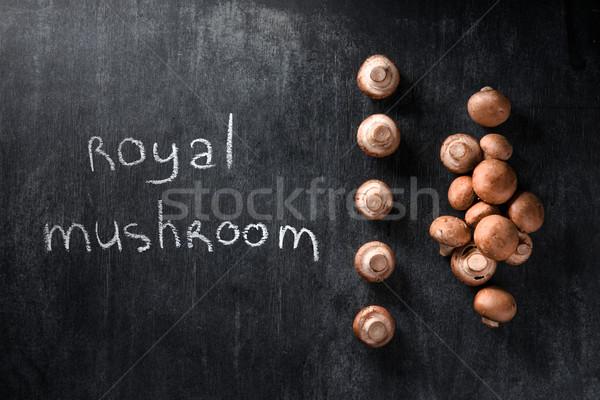 Mushrooms over dark background Stock photo © deandrobot